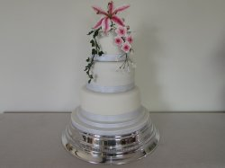 Three tier White  and silver grey with sugar flowers