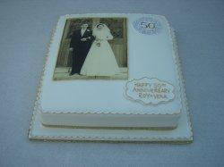 golden wedding cake with photo