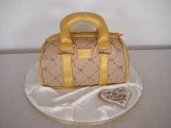 beige-and-gold-gucci-handbag